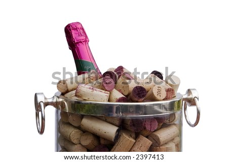 Detail view of a champagne bottle with a pink label in an ice bucket filled with corks. This is a festive image for parties, celebrations, and other happy occasions. Isolated to a white background.