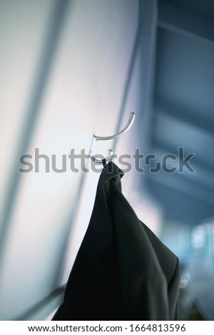 Detail view of a coat hanging on a coat hook