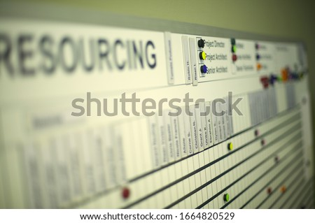 Detail view of a magnet board in office setting