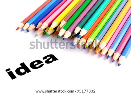 Detail view of many colored pencils near the word idea
