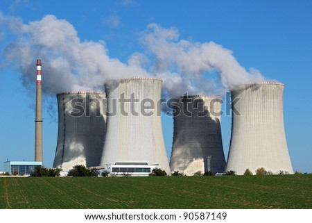 detail view of nuclear power plant with cooling towers