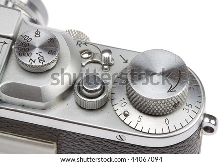 detail view of shutter speed dial on a classic rangefinder camera, isolated on a pure white background