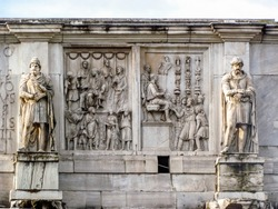 Detail view of statues on Arch of Constantine located in Rome, Italy near the Colosseum.