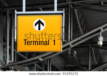 detail view of terminal sign on airport hall - stock photo