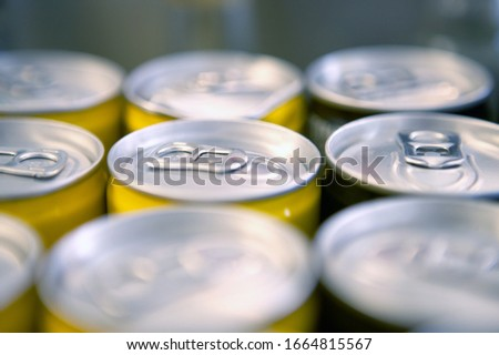 Detail view of the tops of soda cans