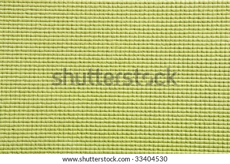 Detail view of yoga mat surface and texture in green