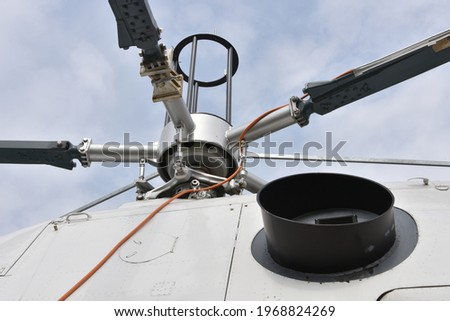 Detail view on main rotor blades and rotor mast of the white twin-engine multi mission or multipurpose Helicopter.  ストックフォト ©