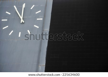 Detail with a traditional sports scoreboard with clock