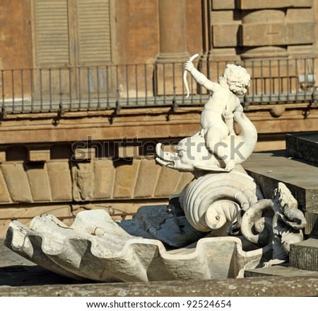 detail with  cherub sitting on dolphin from fountain in Boboli Gardens in  Florence , Unesco World Heritage site, Italy, Europe