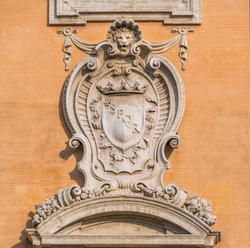 Detail with coat of arms from the facade of the Palazzo Senatorio in the Campidoglio in Rome, Italy.