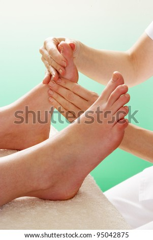 Detail woman having foot massage - stock photo