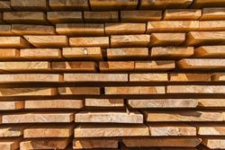 Detail wooden planks. Air-drying timber stack. Wood air drying (seasoning lumber or wood seasoning). Timber. Lumber.