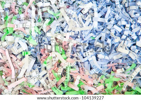 Detailed background image of colorful shredded paper - stock photo