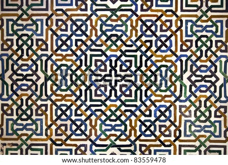 Detailed background  of the intricate tile patterns on a wall of the Nasrid Palace, Alhambra, Granada, Spain