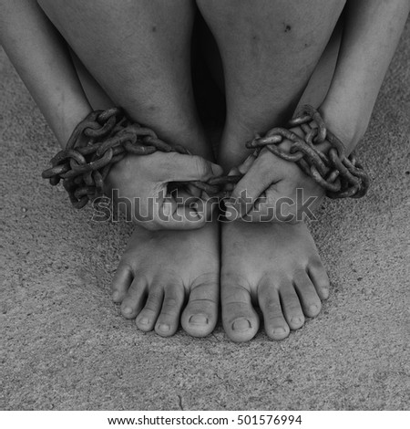 Detailed black and white image blur incredible feet chained. #501576994