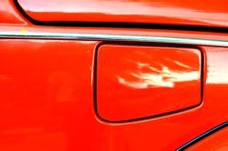 Detailed close up of a petrol cap cover on a reto car