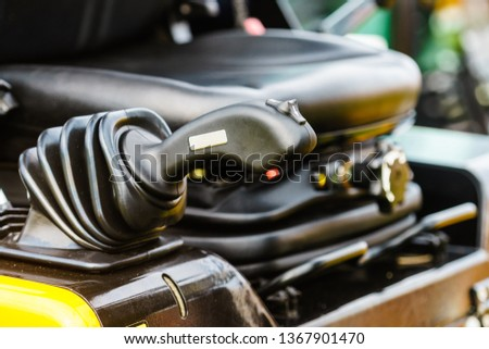 Detailed close up of gear stick in agricultural machine, big vehicle. Inside of truck trailer details concept.