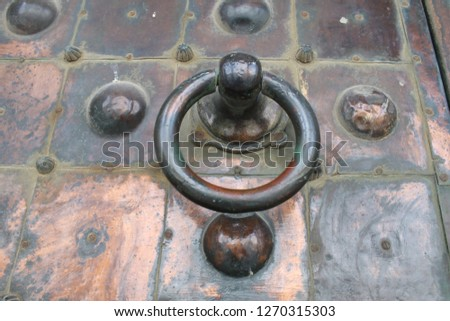 Detailed closeup of copper door and knocker at the entrance gate of the Dome of the Rock Islamic Shrine in the Old City of Jerusalem associated with Prophet Muhammad's Nigh Journey