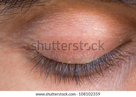 detailed closeup view of caucasian man closed eyelid