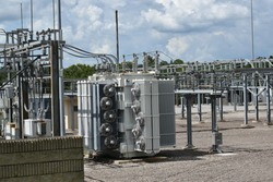 Detailed components are shown at an electrical power substation.