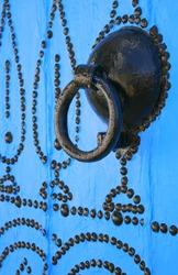 detailed door knocker in tunisian arabic style located in beautiful place Sidi Bou Said Tunisia