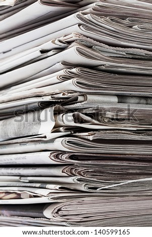 Detailed image of a stack of old newspaper for recycling.