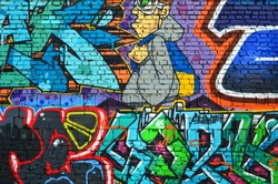 Detailed image of color graffiti drawing. Background Street art background with a painted character. Part of the colorful masterpiece by the professional graffiti artists