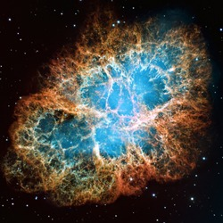 Detailed image of the Crab Nebula in constellation Taurus, blue and orange colors, elements of this image furnished by NASA
