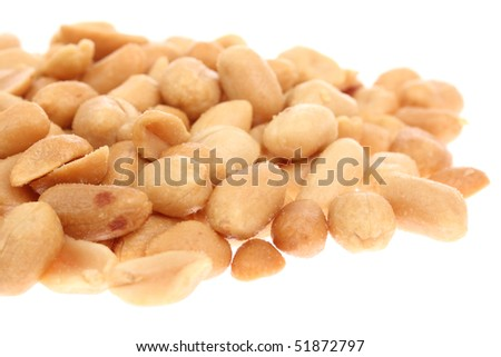 Detailed macro shot of salty peanuts isolated on white