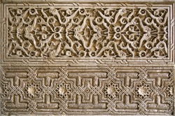 Detailed panel of the intricate patterns on a wall of the Alhambra Palace, Granada, Spain