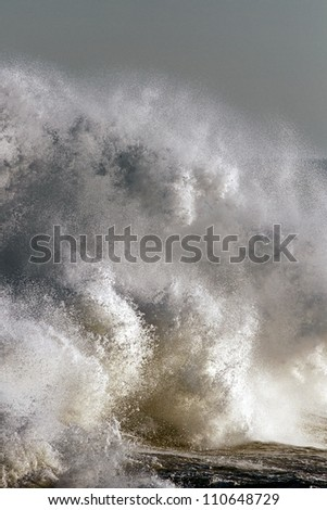 Detailed photo of a big stormy wave crashing over Portuguese Coast