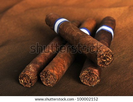 Detailed photo of cigars on the brown background