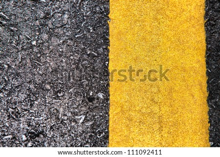 Detailed road texture with yellow stripe - stock photo