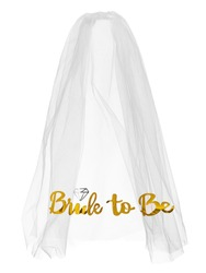 Detailed shot of a white mesh bride veil with golden lettering