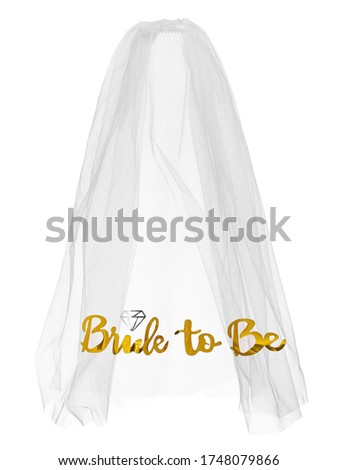 Detailed shot of a white mesh bride veil with golden lettering 'Bride to Be' on the border. The elegant veil is isolated on the white backdrop.  Stockfoto ©