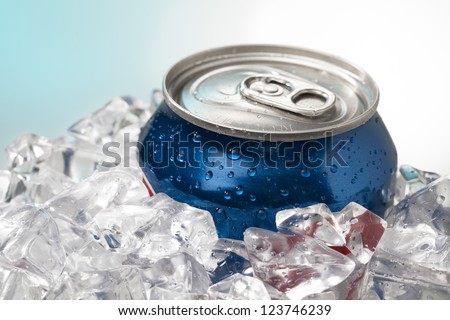 Detailed shot of blue cola can in ice cubes.
