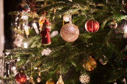 detailed shot of some christmas decoration hanging on a christmastree