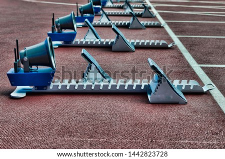 detailed starting blocks ready for crouch start athletic competition #1442823728