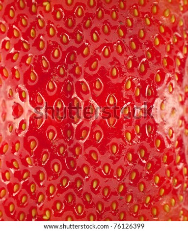 Detailed surface shot of a fresh strawberry.