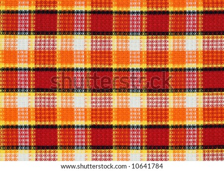 detailed texture of red-yellow-orange fabric pattern