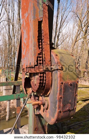 Detailed view at the rusted and crusted mechanical power transmission of an old Dutch  drawbridge.