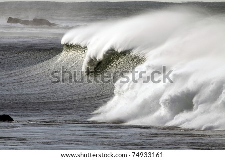 Detailed view of a beautiful big white crashing wave in a stormy day