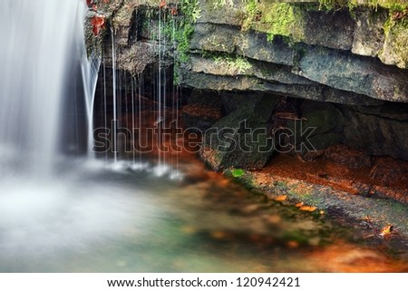 Detailed view of a beautiful fresh waterfall.