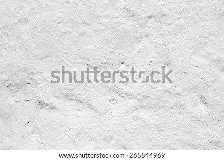 Detailed view of a white painted wall which has been weathered