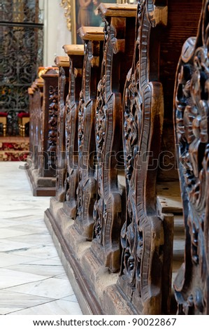 Detailed view of an old wooden church pews.