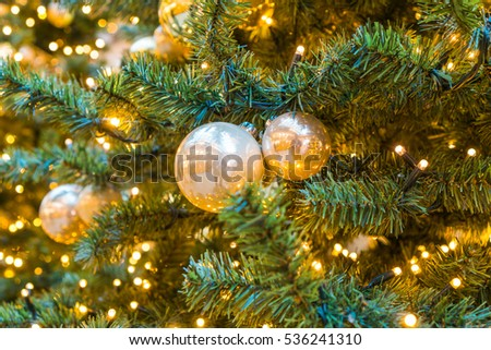 detailed view of christmas decorations on christmas tree with candle lights