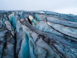 Detailed view of glacier structure with blue vivid colors and dirty ice, Iceland