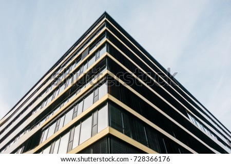 detailed view of modern corner office building