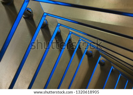 Detailed view of modern metal arch structure with blue light #1320618905