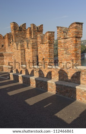Detailed view of old brick bridge Ponte Scaligero in Verona (Italy). Vertically.
